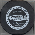 2004-05  Official Game Puck reverse logo. White ring, black letter official game puck. These USHL Official logoed pucks started to phase in during the 04-05 season. It was the main goal to have all the teams using this style puck for games starting the 05-06.