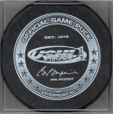 2006-07  Official Game Puck reverse logo. Marked Official Game Puck. This USHL logo has been the official logo on game pucks since the start of the 2004 season. Several teams have also used official game pucks with a sponcer on the reverse as well.